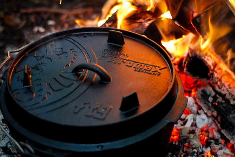 Petromax Dutch Oven over the open fire during outdoor cooking